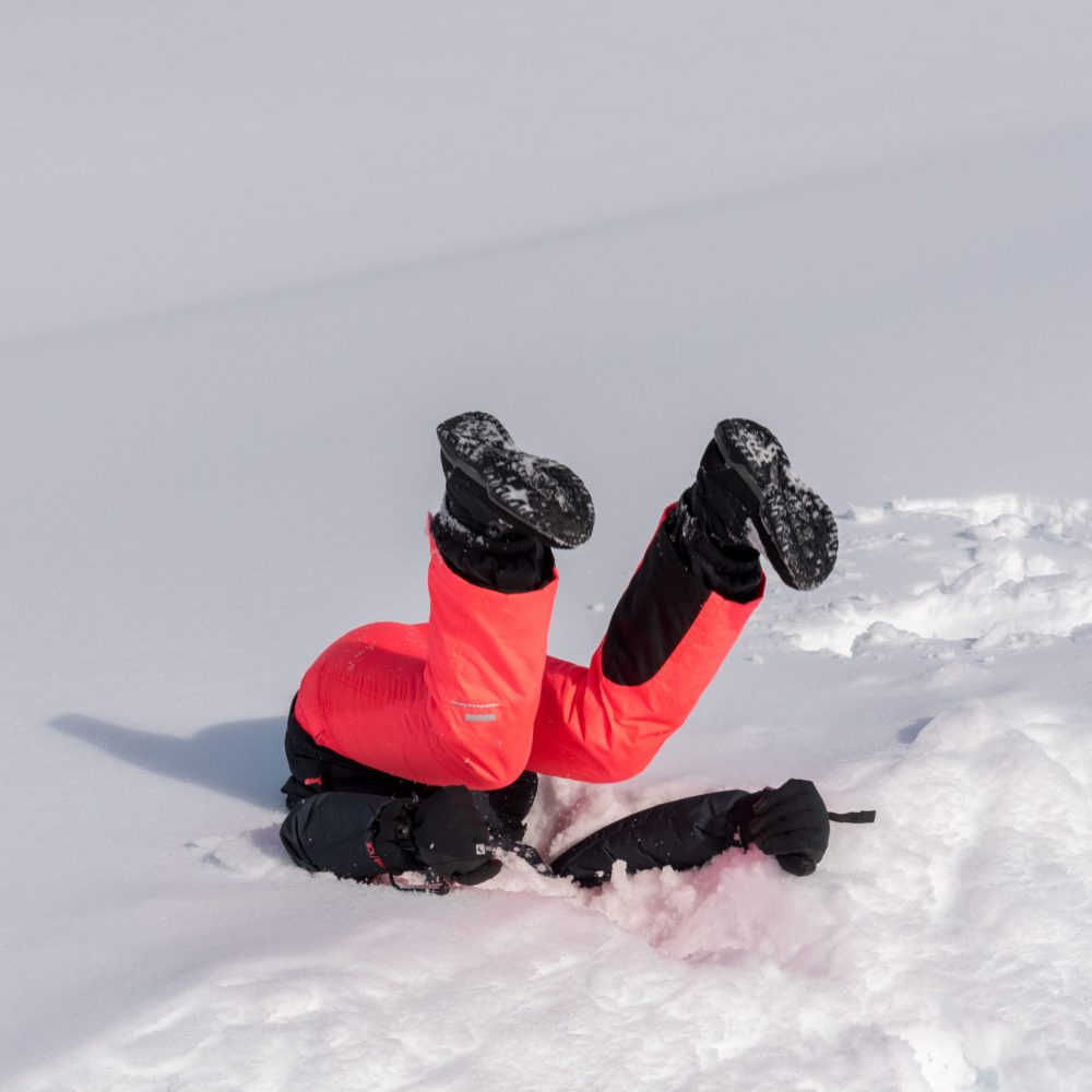 Funny photo of a girl landing in the snow